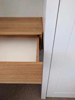 A wall-mounted vanity unit in solid Oak and Oak veneer. Designed and made by Cook Joinery, London.