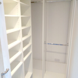 A walk-in wardrobe designed and fitted by Cook Joinery, London.