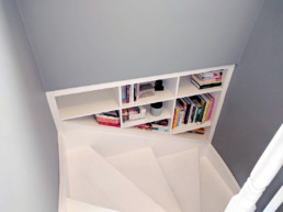 Bookcase and vinyl storage nook to fit a space on the stairs. Made by Cook Joinery, London.