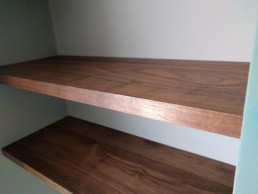 Solid Walnut shelving made by Cook Joinery, London.