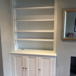 An alcove cabinet made by Cook Joinery, London. Hand painted in Farrow & Ball's 'James White'.